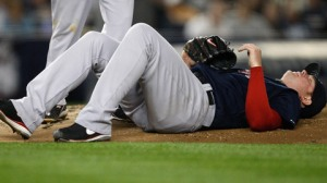 Jon Lester lays on the ground after getting hit in the right quad by a liner. (Jared Wickerham/Getty)