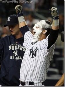 Nisk Swisher celebrates after getting pie in face from A.J. Burnett (background)
