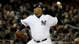 Oct 28, 2009.  CC Sabathia delivers against the Phillies during Game 1 of the World Series. (Getty)