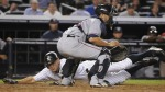 Jun 16--Johnny Damon slides past Wil Nieves to score in the seventh on Tuesday. (AP)