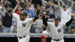 May 23--Robinson Cano (left) and coach Rob Thompson celebrate after Cano scored the winning run. (AP)
