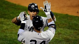Oct 31, 2009--Alex Rodriguez and Mark Teixeira celebrate A-Rod's fourth-inning homer Saturday. (Getty)
